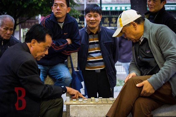 Hong Kong men playing boardgames